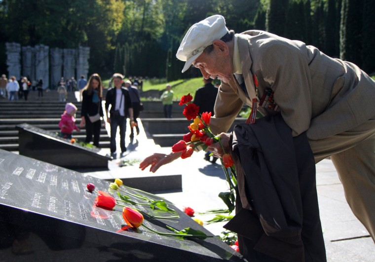 May 9, 2012: Usirov Usthan, a 92-year-old veteran of World War II, lays flowers by the monument of the Unknown Soldier at the Antakalnis memorial during Victory Day celebrations in Vilnius, Lithuania. (Petras Malukas/AFP/Getty Images)