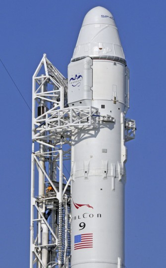 May 19, 2012: SpaceX's Falcon 9 rocket remains on the launch pad as engineers check the main engine section. The launch attempt with the company's Dragon capsule to the International Space Station from launch complex 40 at Cape Canaveral, Florida was aborted when one of the nine main engine appeared to falter. (Bruce Weaver/AFP/Getty Images)