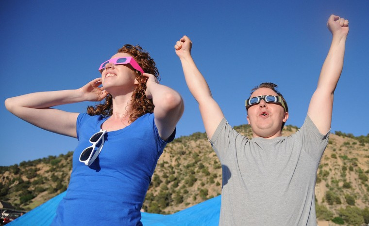 "Will Bowen (R), 29, of St George, Utah reacts to the perfect ""ring of fire"" annular solar eclipse in Kanarraville, Utah. (Robyn Beck/AFP/Getty Images)"