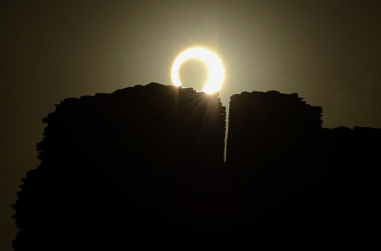 The moon appears to cover the sun during an annular eclipse of the sun May 20, 2012 as seen over the Pueblo Bonito ancient building at Chaco Culture National Historical Park in northwestern New Mexico. (Stan Honda/AFP/Getty Images)