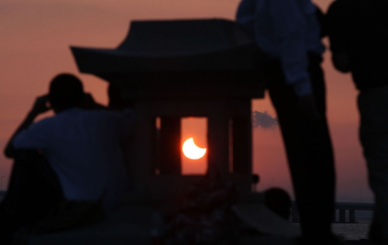 A partial annular solar eclipse is seen from the coast of Xiamen, in China's southeast province of Fujian on May 21, 2012. (AFP Photo/AFP/Getty Images)