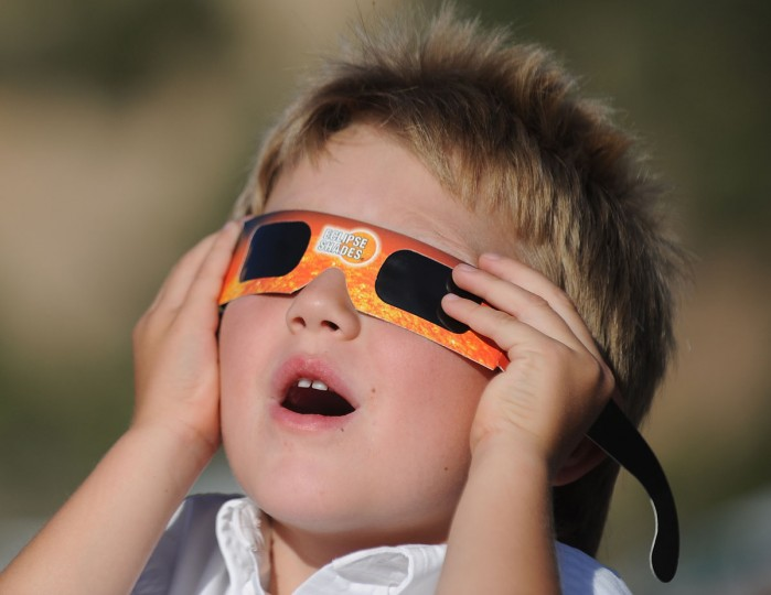 Aaron Peck, 4, watches the annular eclipse in Kanarraville, Utah. (Robyn Beck/AFP/Getty Images)
