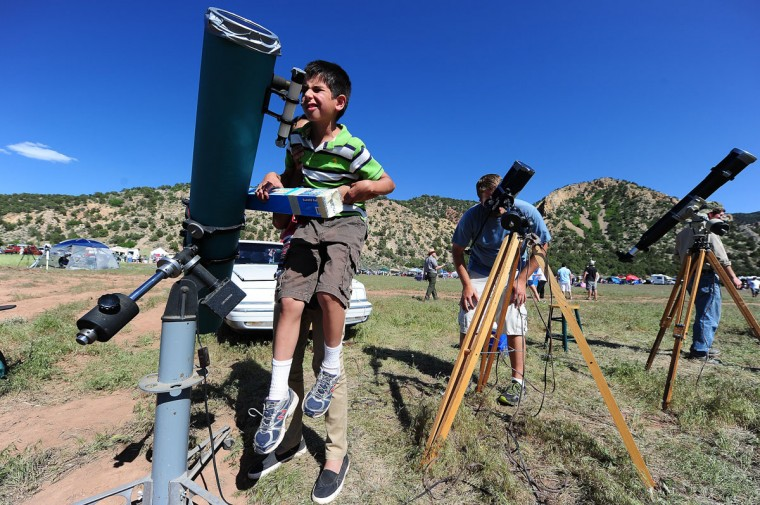 Andre Paulsen, 7, watches the solar eclipse in Kanarraville, Utah. (Robyn Beck/AFP/Getty Images)