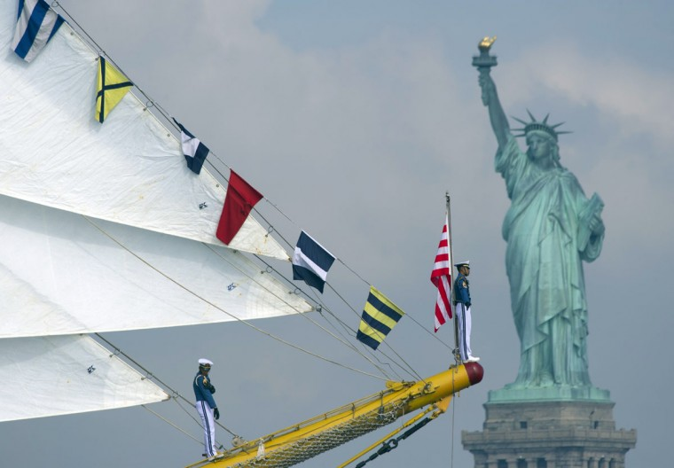 Sailors aboard the tall ship from Indonesia Dewaruci sail past the Statute of Liberty May 23, 2012 in New York. The tall ship is participating in Fleet Week events in New York. (Don Emmert/AFP/Getty Images)