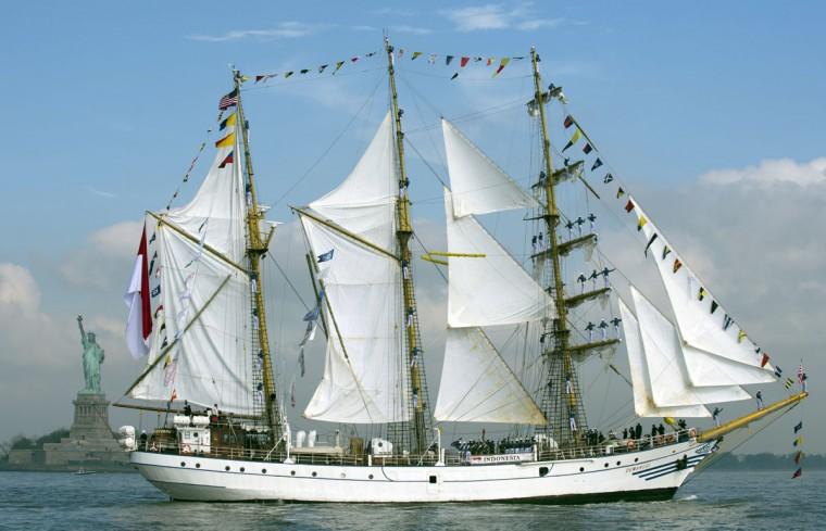 The sails from the tall ship from indonesia Dewaruci as she sails past the Statute of Liberty May 23, 2012 in New York. The tall ship is participating in Fleet Week events in New York. (Don Emmert/AFP/Getty Images)
