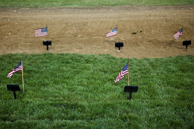 Flags are seen at the temporary markers of recent graves in Section 60, an area largely used for those who died while serving in the wars in Afghanistan and Iraq, at Arlington National Cemetery May 24, 2012. (Brendan Smialowski/AFP/Getty Images)
