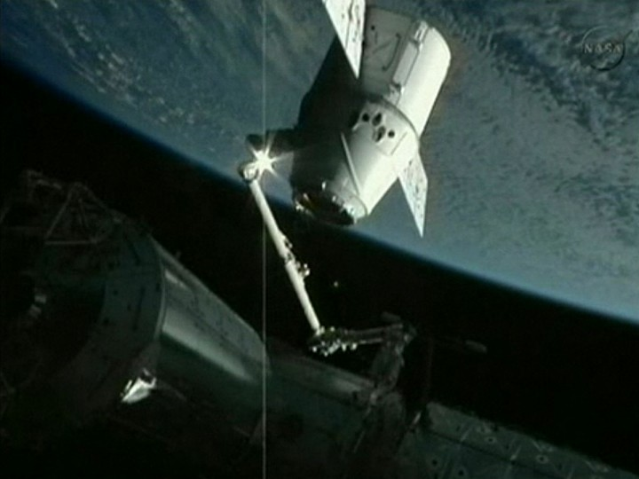 In this frame grab from a NASA video, the robotic arm of the International Space Station holds the SpaceX Dragon capsule as astronauts prepare to dock the capsule with the station. SpaceX has become the first private company to rendezvous with the orbiting lab. (NASA/AFP Photo/GettyImages)
