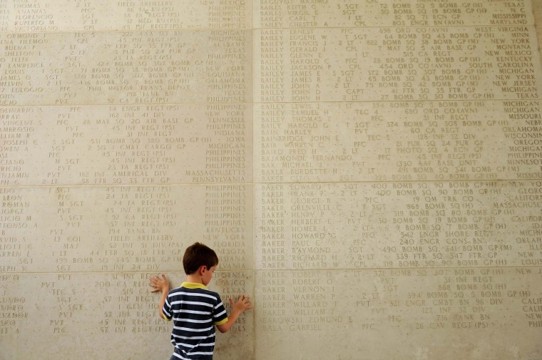 A young boy looks at a wall with engraved names of soldiers who fell during World War II at a service to mark U.S. Memorial Day at the Manila American Cemetery in Fort Bonifacio in the Philippine capital Manila on May 27, 2012. At least 17,000 graves are in the park that pays tribute to US and Philippines soldiers that fought side by side during World War II. (Noel Celis/AFP/Getty Images)