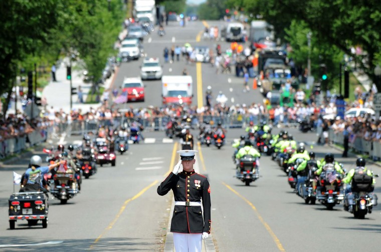 A Marine salutes as motorcyclists ride past during Rolling Thunder 2012 in Washington, DC, on May 27, 2012. (Jewel Samad/AFP/Getty Images)