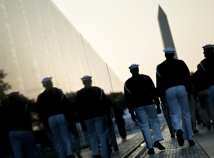 Sailors walk past the Vietnam Memorial Wall May 28, 2012 in Washington, DC. (Brendan SmialowskiAFP/Getty Images)