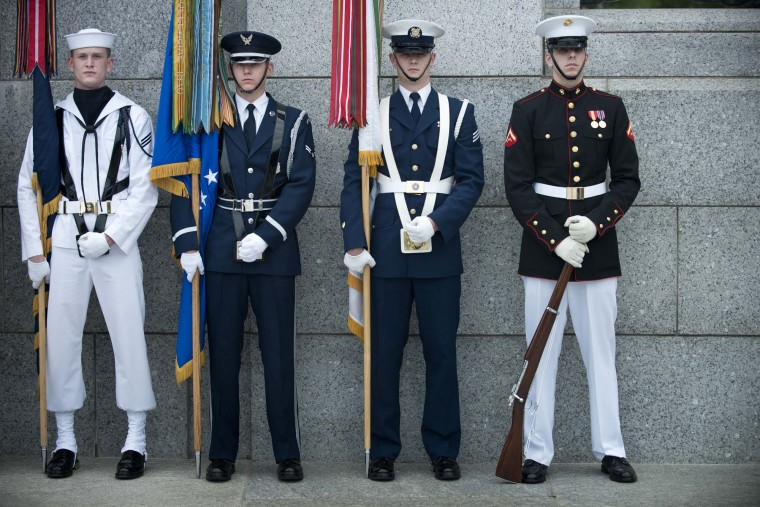A U.S. Military color guard stands ready for a wreath laying ceremony at the World War II Memorial on May 28, 2012 in Washington, DC. (Brendan Smialowski/AFP/Getty Images)