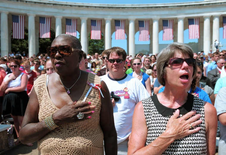Attendees stand for the U.S. National Anthem during a ceremony marking Memorial Day May 28, 2012 at Arlington National Cemetery. (Mandel Ngan/AFP/Getty Images)