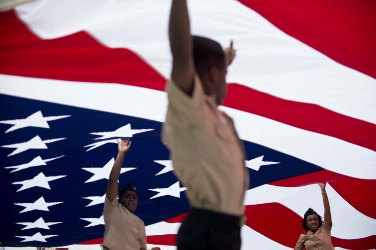 Members of the US Navy's JROTC hold up a giant American flag during a Memorial Day parade along Constitution Avenue May 28, 2012 in Washington, DC. (Brendan Smialowski/AFP/Getty Images)