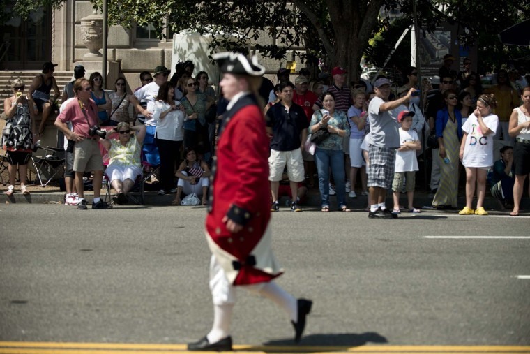 People watch as a man dressed in an American Revolution era uniform passes during a Memorial Day parade along Constitution Avenue May 28, 2012 in Washington, DC. (Brendan Smialowski/AFP/Getty Images)