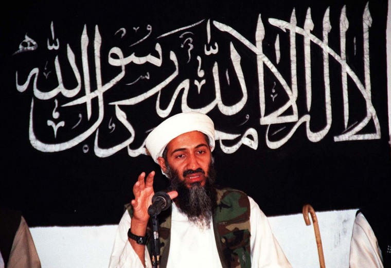 """This undated file picture shows Osama bin Ladin speaking at an undisclosed place. Al-Qaida mastermind Osama bin Laden was killed on May 2, 2011 in a firefight with covert U.S. Special Forces deep inside Pakistan in Abbottabad, prompting U.S. President Barack Obama to declare """"justice has been done"""" a decade after the September 11 attacks. A $25-million bounty was on the head of bin Laden for information leading to his apprehension and conviction. (STR/AFP/Getty Images)"""