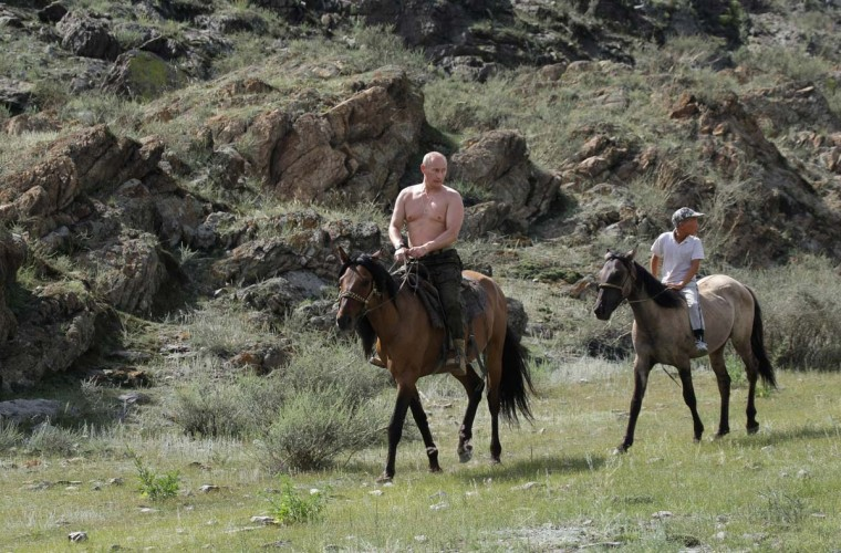 2009: Russian Prime Minister Vladimir Putin rides a horse during his vacation outside the town of Kyzyl in Southern Siberia on August 3, 2009. (Alexsey Druginyn/AFP/Getty Images)