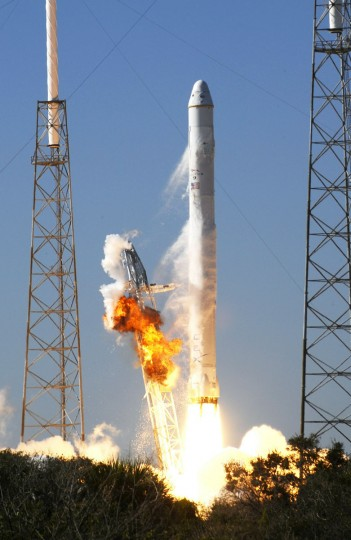 December 8, 2010: SpaceX's Falcon 9 rocket lifts off from launch pad 40 at Cape Canaveral, Florida. SpaceX successfully launched the Dragon space capsule into orbit, marking the first such attempt by a private enterprise that could pave the way for the future of space travel. The spacecraft was to circle the Earth twice before attempting a re-entry from low orbit and a splash landing into the Pacific Ocean, a risky operation that even the company said carried about a 70 percent likelihood of success. (Bruce Weaver/AFP/Getty Images)