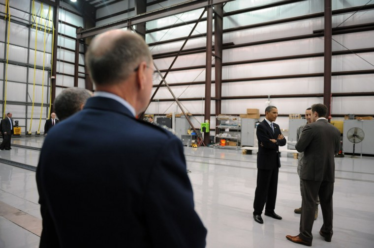 April 15, 2010: US President Barack Obama tours the SpaceX launch pad at the Kennedy Space Center in Cape Canaveral, Florida. Obama traveled to Florida in a bid to soothe critics of his plan to scrap an over-budget Moon launch program and reshape NASA's future. (Jewel Samad/AFP/Getty Images)