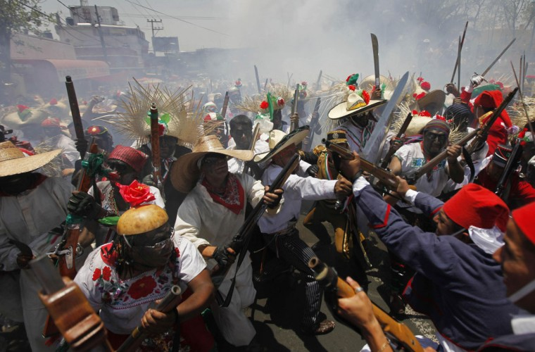 People take part in a recreation of the Battle of Puebla during Cinco de Mayo celebrations in Mexico City on May 5, 2010. On May 5, 1862, Mexican forces loyal to Benito Juarez defeated French troops sent by Napoleon III in the Battle of Puebla, in Puebla, central Mexico. (Eduardo Verdugo/AP Photo)