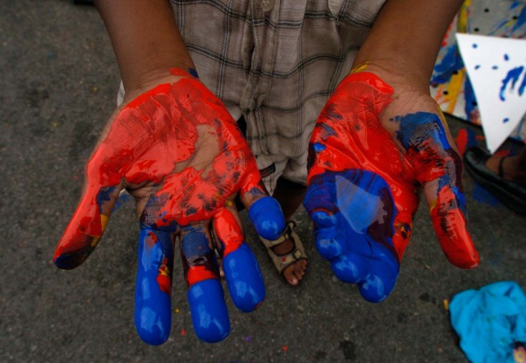 Wanna shake hands? Here's a detail shot an artist-in-training's paint-covered hands at the 2004 Sowebohemian Arts and Music Festival. (John Makely/Baltimore Sun, May 30, 2004).