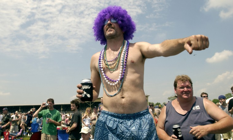 Bill Taylor of Brooklyn Park decided purple would be his color for the 129th Preakness in 2004. (Christopher T. Assaf/Baltimore Sun)