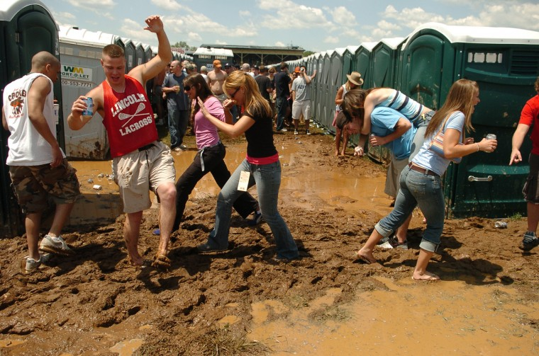 People attending the 2005 Preakness Stakes had to traverse muddy conditions in the infield in order to use the facilities. (Gene Sweeney/Baltimore Sun)