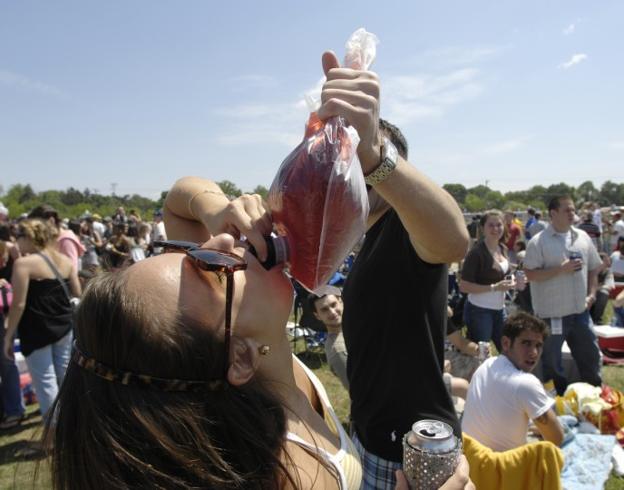 "Alyssa Molnar, Cincinnati, Ohio, takes a swig of ""boxed"" wine in the 2007 Preakness infield. (Christopher T. Assaf/Baltimore Sun)"
