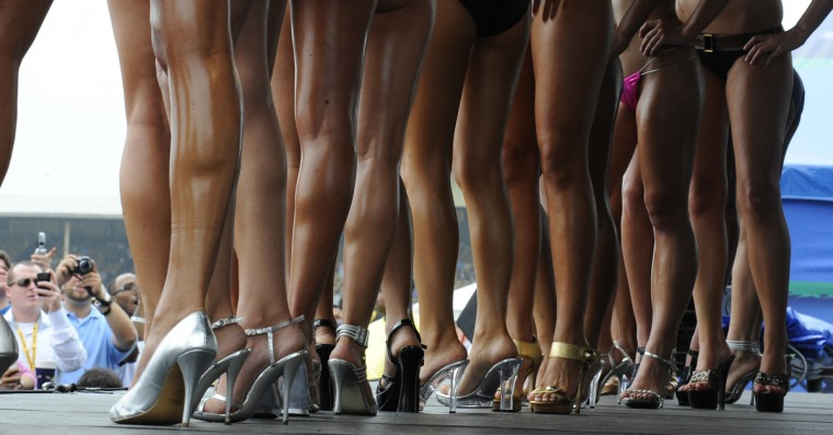 Contestants line up for the bikini contest in the infield at the 2009 Preakness. (Lloyd Fox/Baltimore Sun)