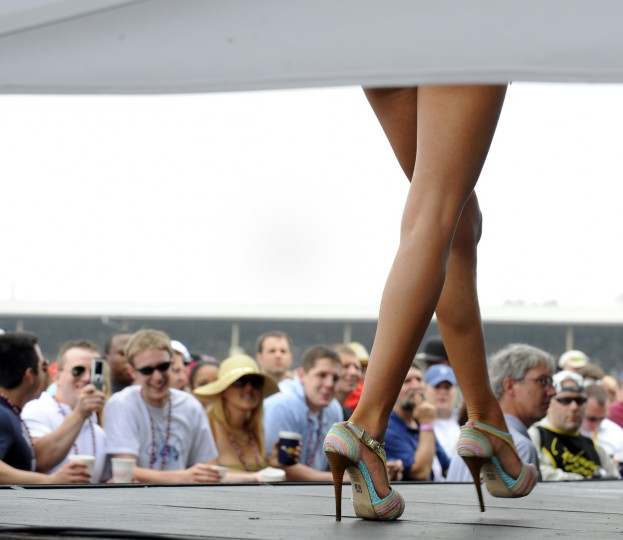 A bikini contest contestant walks across the infield stage during the 2009 Preakness. (Lloyd Fox/Baltimore Sun)
