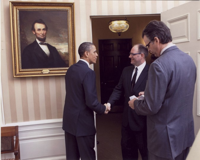 President Barack Obama greets Baltimore Sun video editor Christopher T. Assaf as he enters the Oval Office in 2011. Like a victorious sports team, first place winners in the White House News Photographers Association's 'Eyes of History' contest get the opportunity visit the president at the White House. (White House)