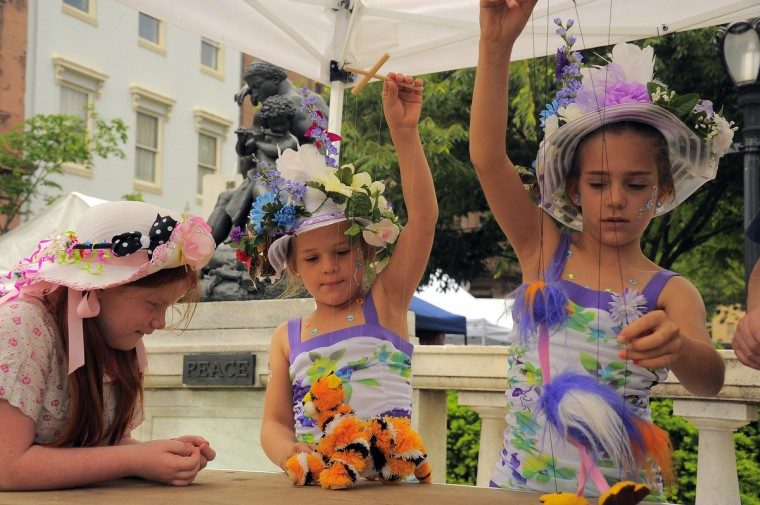 Alyssa Jefferson, 7 of Baltimore watches Hannah Gardner, 7 and sister Hailey Gardner, 8 of Elkridge prepare for the Grand Hat Contest at Baltimore's FlowerMart. (Karl Merton Ferron / Baltimore Sun Staff)
