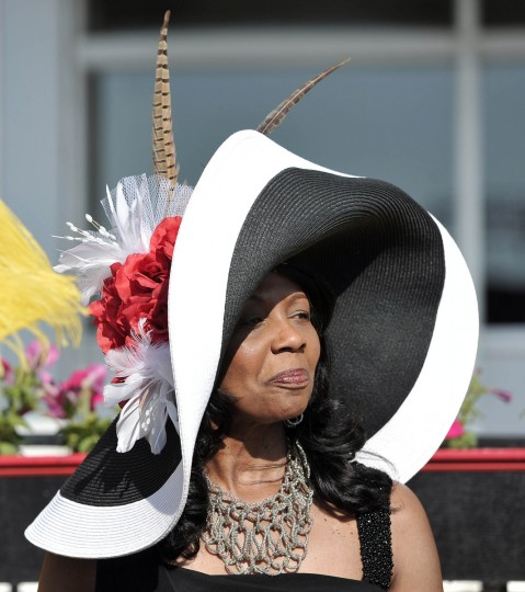 "Shelley Forbes-Eford, Baltimore, wears a hat created by Marjae Hicks, owner of See the Difference/Hats by Marjae in Westminster. The hat is called ""Springtime."" She is at Pimlico Race Course where hats will be plentiful tomorrow at the Preakness. (Kim Hairston/Baltimore Sun)"