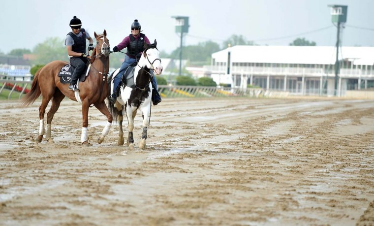 Exercise rider Johnny Garcia and Kentucky Derby winner I'll Have Another take to the track at Pimlico Race Course. (Kim Hairston/Baltimore Sun)