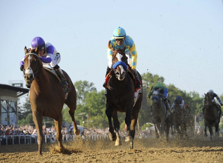 I'll Have Another, left, overtakes Bodemeister at the finish to win the 137th Preakness Stakes at Pimlico Race Course on Saturdday, May 19, 2012, in Baltimore, Maryland. (Gene Sweeney Jr./Baltimore Sun)