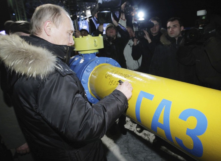 2011: Vladimir Putin signs a pipe during a ceremony to launch gas at 'Dalneye' gas-distribution station in the Far Eastern city of Yuzhno-Sakhalinsk March 19, 2011. Putin on Sunday offered Japanese companies stakes in two major Siberian gas fields which hold total reserves of about 3.2 trillion cubic metres. The pipe reads 'Gas'. (Alexsey Druginyn/Reuters)