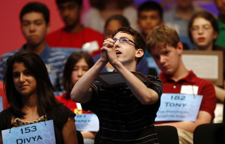 June 1, 2011: Adam Ferrari (front), of Johnstown, New York, celebrates spelling his word correctly during round three of the 2011 Scripps National Spelling Bee at the Gaylord National Resort and Convention Center at National Harbor, Maryland. (Molly Riley/Reuters)
