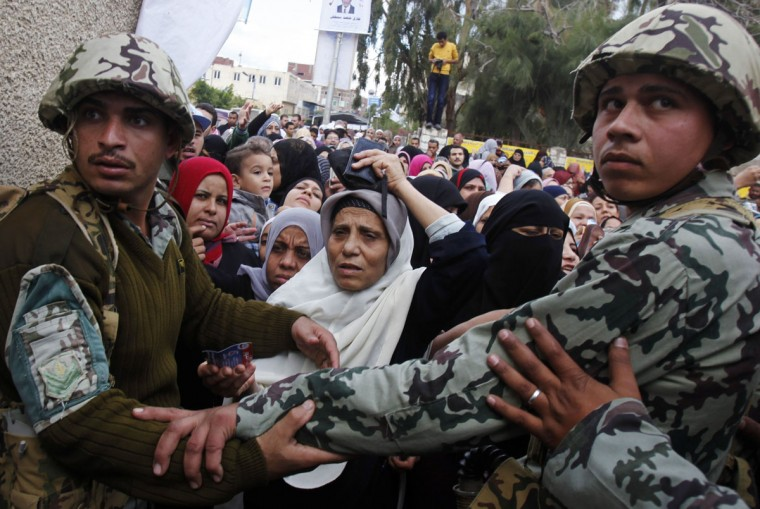 November 28, 2011: Soldiers maintain order as people wait outside a polling station to cast their votes during parliamentary elections in Alexandria. (Mohamed Abd El-Ghany/Reuters)