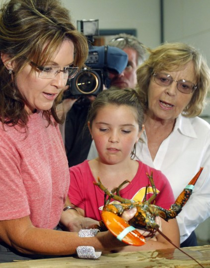 The pit-bull politician, past Vice President nominee and hockey mom Sarah Palin campaigned frequently with her family in 2008 and has since become a political correspondent, TV personality and reality show star, all while keeping her family in her sights. Pictured: Former Alaska Governor Sarah Palin (L) looks at a lobster with her daughter Piper (C) and her mother Sally Heath during a visit to Yankee Seafood Cooperative in Seabrook, New Hampshire on June 2, 2011. (Brian Snyder/Reuters)