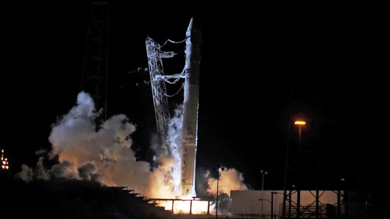 May 19, 2012: SpaceX attempts to launch its Falcon 9 rocket at Cape Canaveral, Florida. The launch was aborted right before the countdown reach zero when flames began curling beneath the rocket. It was quickly extinguished and full ignition was prevented by computer. (Red Huber/Orlando Sentinel/MCT)