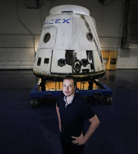 April 19, 2012: CEO Elon Musk with the SpaceX Dragon capsule on display at the Hawthorne, California-based Space Exploration Technologies Corp. (Brian van der Brug/Los Angeles Times/MCT)