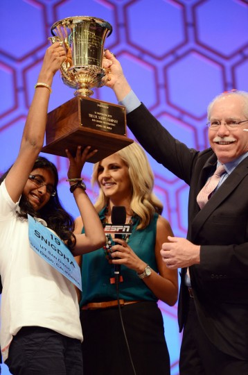 May 31, 2012: Snigdha Nandipati of San Diego, California, left, hoists the championship trophy with Richard A. Boehne, President and CEO of The E.W. Scripps Company, Nandipati won the 2012 Scripps National Spelling Bee in National Harbor, Maryland. (Chuck Myers/MCT)