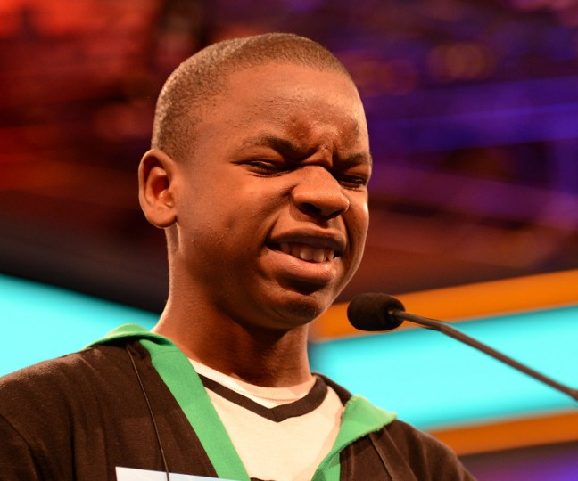 "May 31, 2012: Grifton Wright of Jamaica, grimaces after misspelling ""ericeticolous"" during the final rounds of the 2012 Scripps National Spelling Bee in National Harbor, Maryland. (Chuck Myers/MCT)"