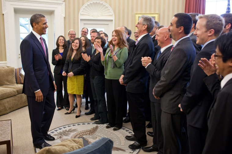 President Barack Obama gets a laugh from the White House News Photographers Association '€œEyes of History' competition winners in the Oval Office, April 11, 2012. (Pete Souza/White House)