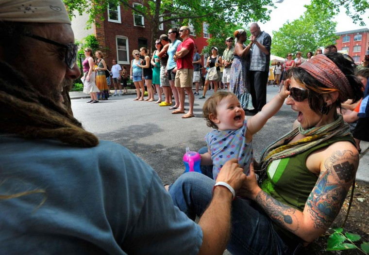 Year-old Lotus Lightchaser enjoys live music with her parents, Michael (left) and Alina Lightchaser at the 2009 Sowebohemian Arts and Music Festival. (Amy Davis/Baltimore Sun, May 24, 2009)