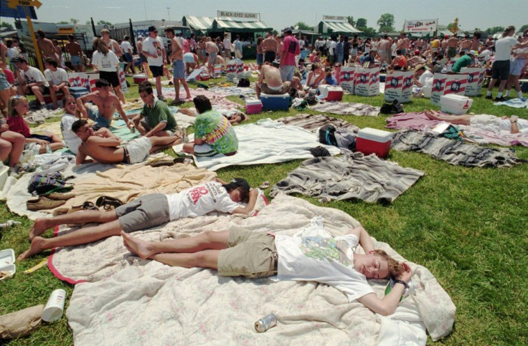 Carroll County youths sleep in the Preakness infield having arrived when the gates opened at 8 AM for the 1993 race. (Gene Sweeney/Baltimore Sun)