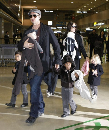 Angelina and Brad have been a couple since 2005 and are raising six children together. Pictured: Actors Brad Pitt and Angelina Jolie arrive with their children at Narita airport, near Tokyo on January 27, 2009. Their children, Pax (L), Knox Leon (carried by Pitt), Maddox (obscured), Zahara, Vivienne Marcheline (carried by Jolie) and Shiloh, are seen. (Toru Hanai/Reuters)