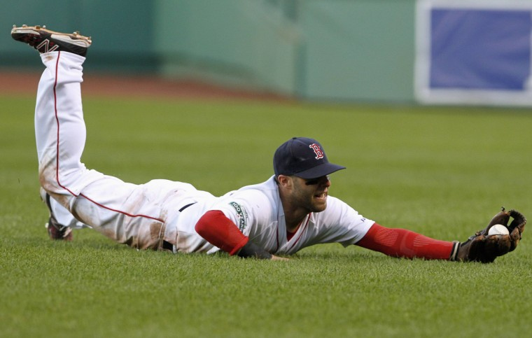 Boston Red Sox second baseman Dustin Pedroia catches Baltimore Orioles' Robert Andino out during the 16th inning of American League MLB baseball action at Fenway Park in Boston. (Jessica Rinaldi/Reuters photo)