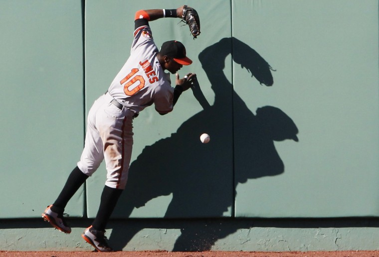 Baltimore Orioles center fielder Adam Jones can't catch a double hit by Boston Red David Ortiz during the eighth inning of American League MLB baseball action at Fenway Park in Boston. (Jessica Rinaldi/Reuters photo)