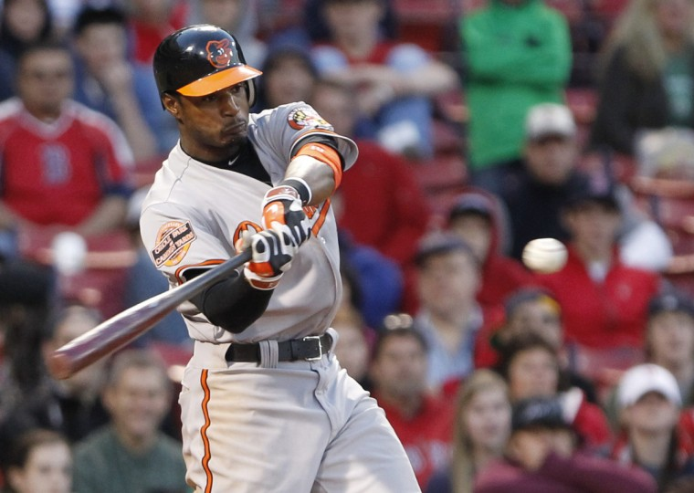 Baltimore Orioles Adam Jones follows through on the swing of his three run home run against the Boston Red Sox during the 17th inning that put the Orioles on top 9-6. (Jessica Rinaldi/Reuters photo)
