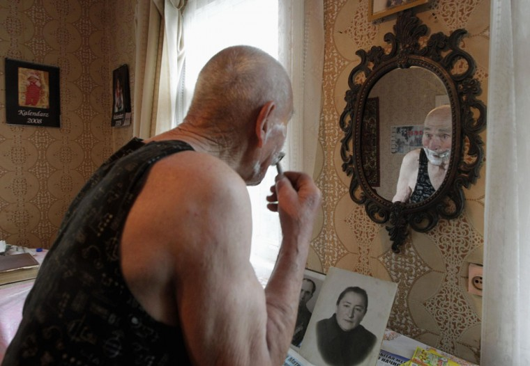 May 8, 2012: World War Two veteran Alexander Blotsky, 92, shaves inside his house on the eve of Victory Day in the town of Turov, some 270 km (167 miles) south of Minsk, Belarus. (Vasily Fedosenko/Retures)